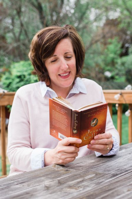 woman reading Jesus Calling book devotional