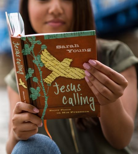 Teen reading Jesus Calling devotional with teen cover