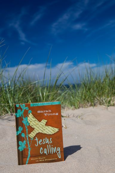 Jesus Calling with Teen cover in sand at the beach
