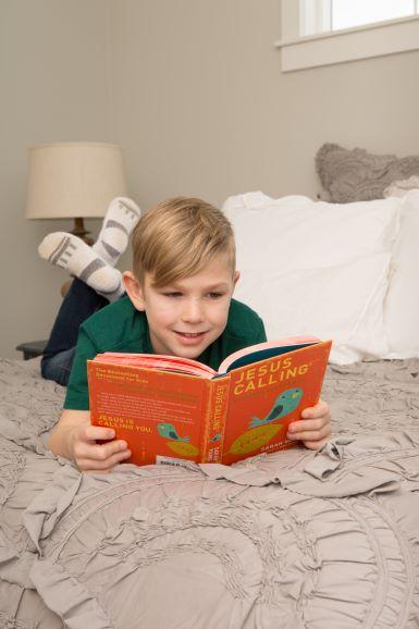 Child reading Jesus Calling 365 devotions for Kids