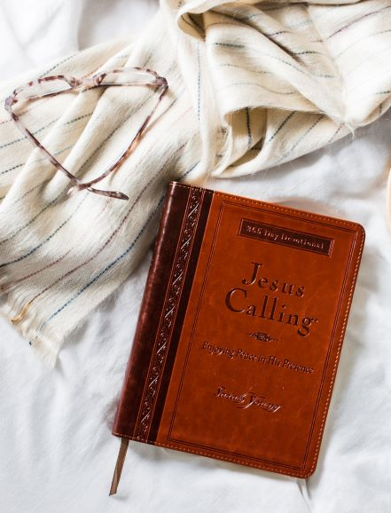 Jesus Calling large deluxe brown edition on blankets with glasses