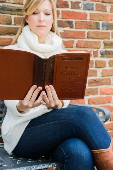 woman reading Jesus Calling large deluxe brown edition