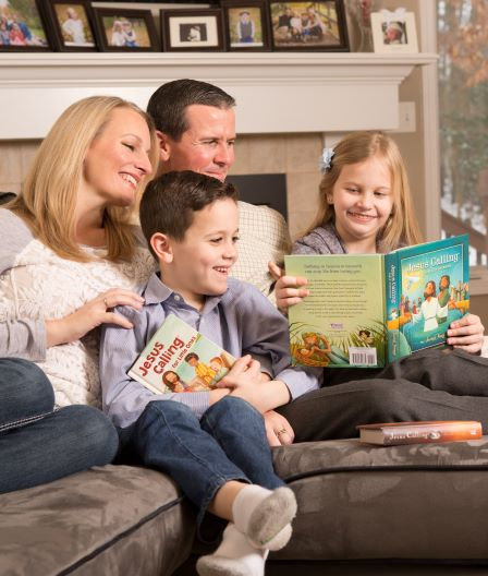 Family reading Jesus Calling Bible storybook with other books in picture