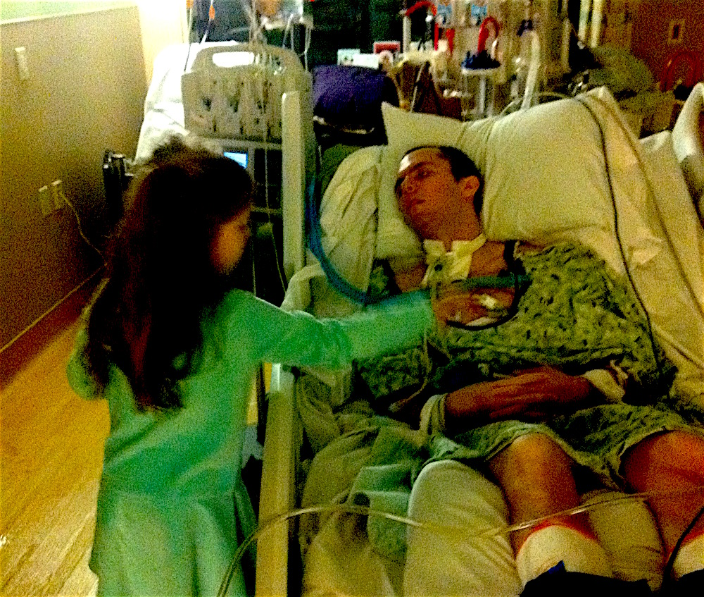 Caleb lies in a coma at the hospital while his family reads Jesus Calling.