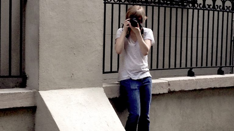 Meg with camera in New orleans