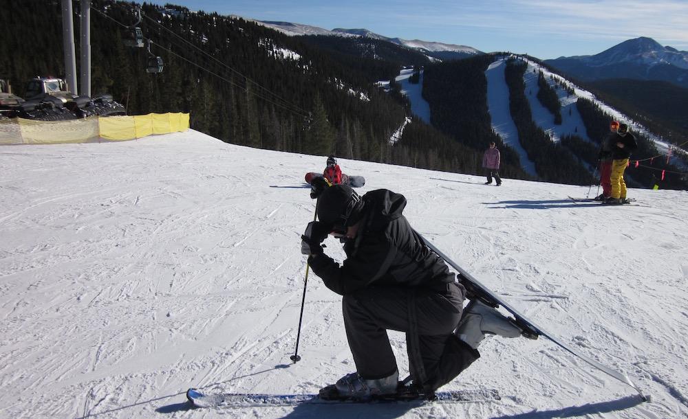 Caleb does a 'prayer pose' at the top of a ski run.
