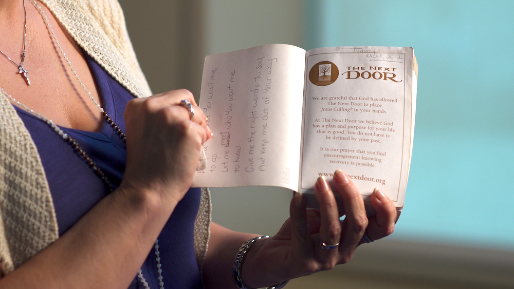 Tammy shows her worn copy of Jesus Calling.