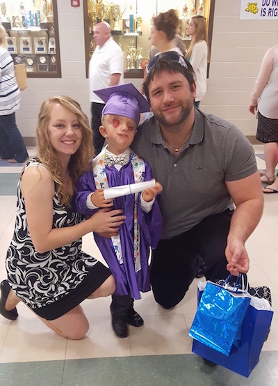 Lacey Buchanan with her husband and son, Christian, during his kindergarten graduation.