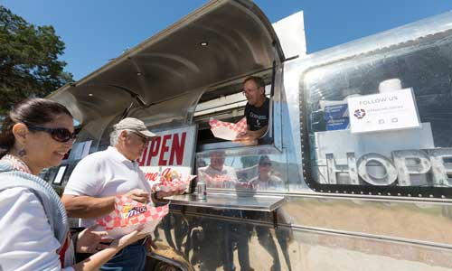 Alan Graham's Mobile Loaves & Fishes food truck serving food to those in need.
