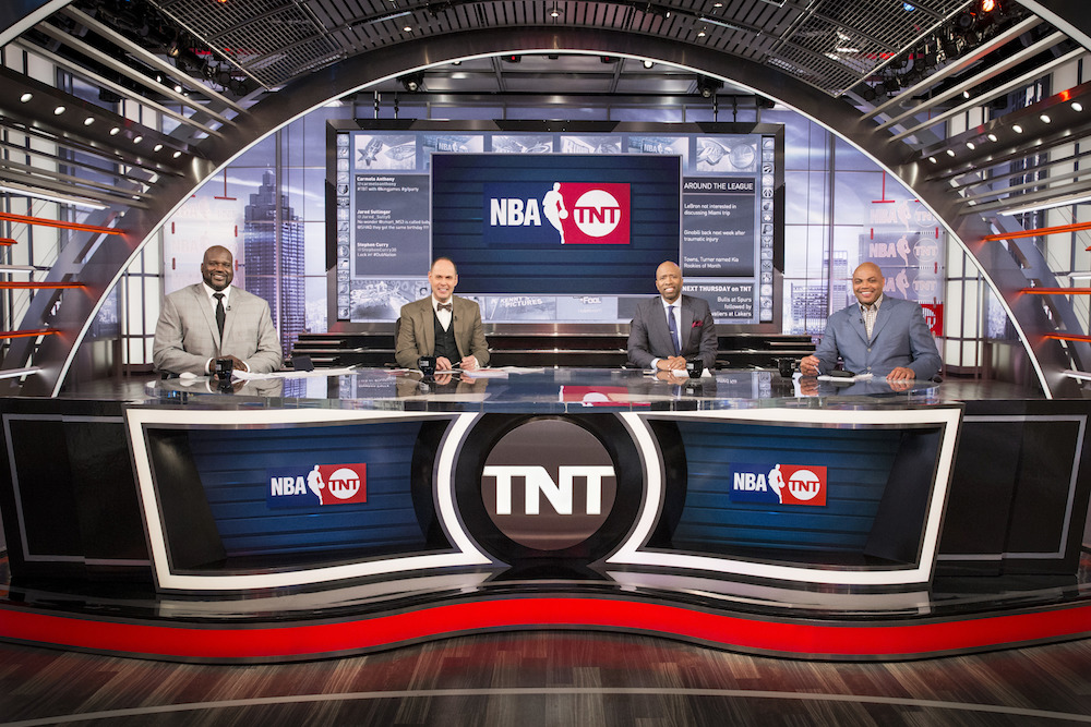 Ernie Johnson, Jr. and his co-hosts on the set of TNT's Inside the NBA.