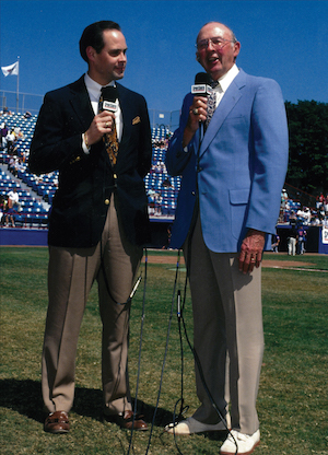 Ernie Johnson, Jr. with his dad on the field.