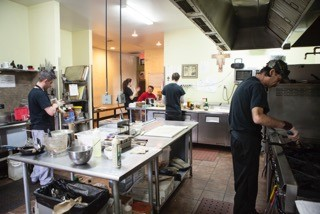 Brett's employees in the kitchen of The Cookery.