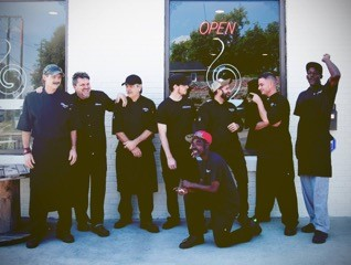 Brett with his team outside of The Cookery.