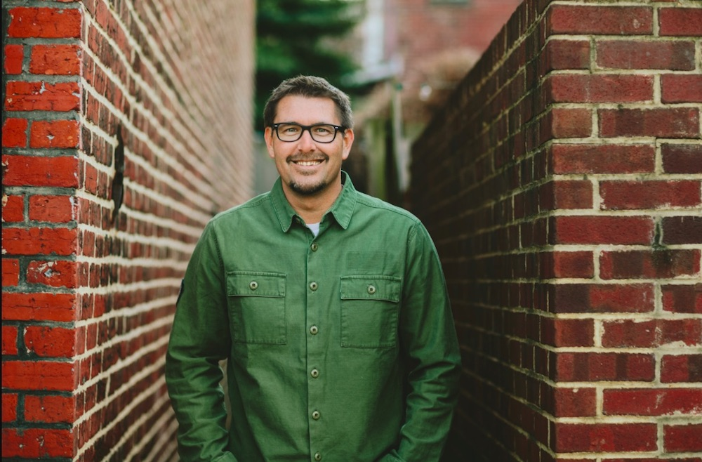 Pastor Mark Batterson standing in an alley.