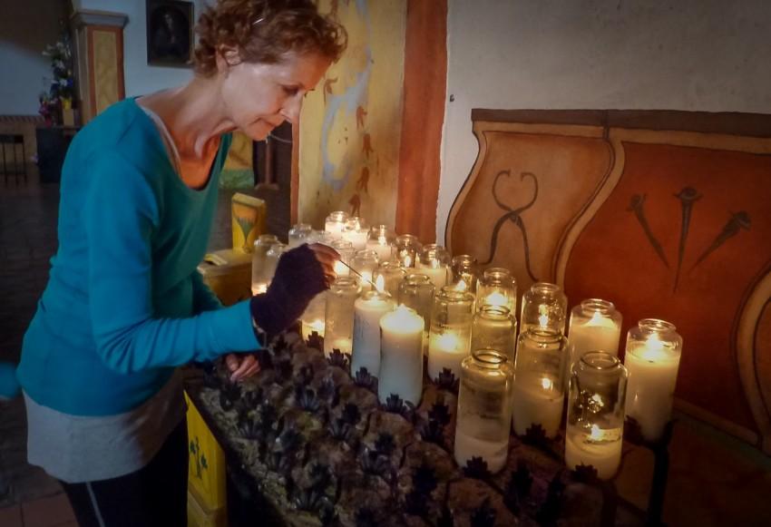 Edie Sundby lighting candles.