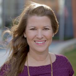 A headshot of Sami Cone.