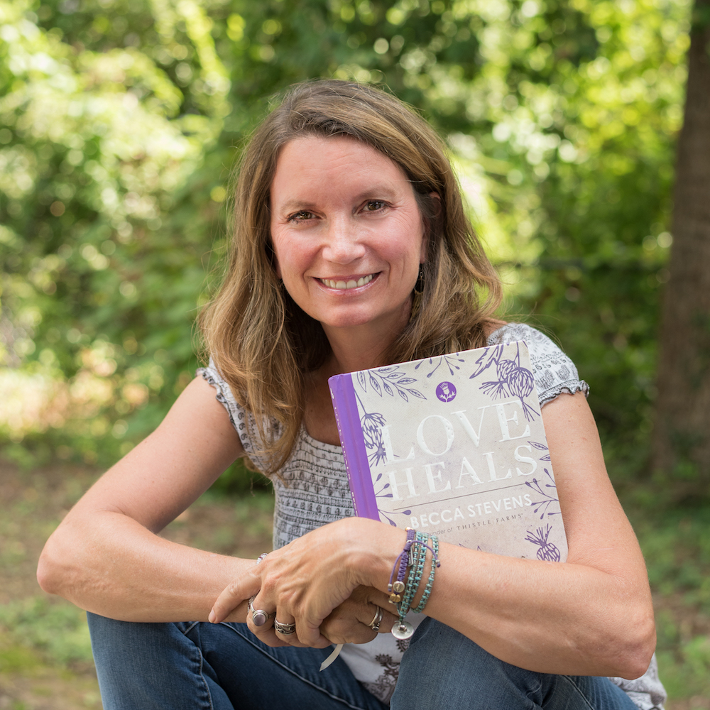 Becca Stevens with her book, Love Heals