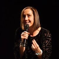 Christine Caine speaking to an audience.