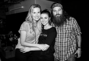 Sadie Robertson with her mom and dad