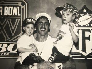 Winning photo of Super Bowl Champion quarterback, Jeff Hostetler and his children