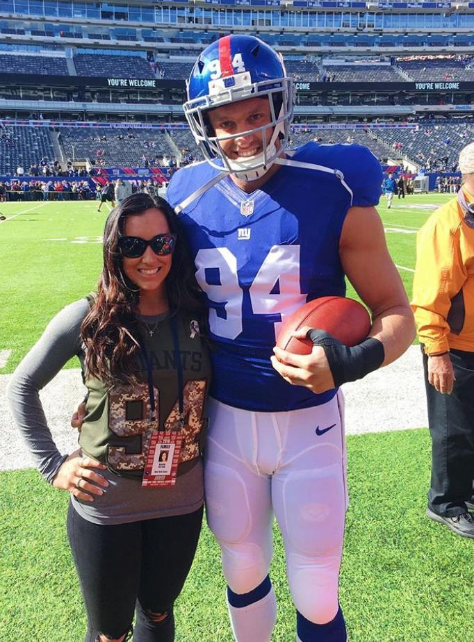 Mark & Danielle Herzlich on the field during pregame