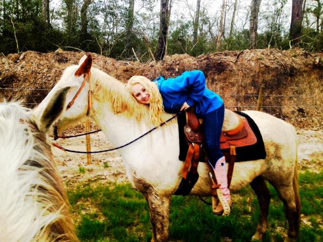 Country artist, RaeLynn on a horse