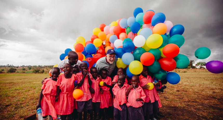 Bob Goff and students with balloons from the school in Africa