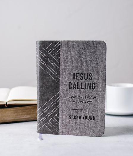 Jesus Calling gray edition on table with mug