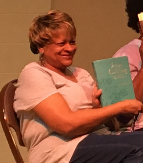 Josephine Smith holds the Jesus Calling devotional and shares how the Jesus Calilng Devotional became such an important part of her life as she united with her women's group to read Jesus Calling and pray