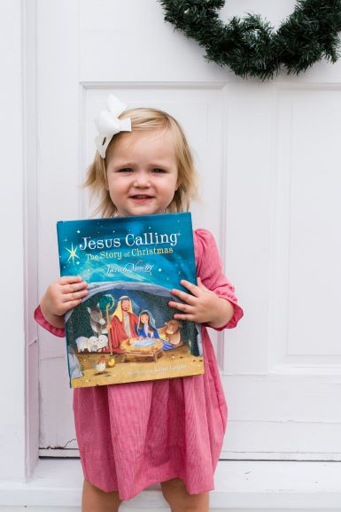 Toddler holding Jesus Calling Story of Christmas