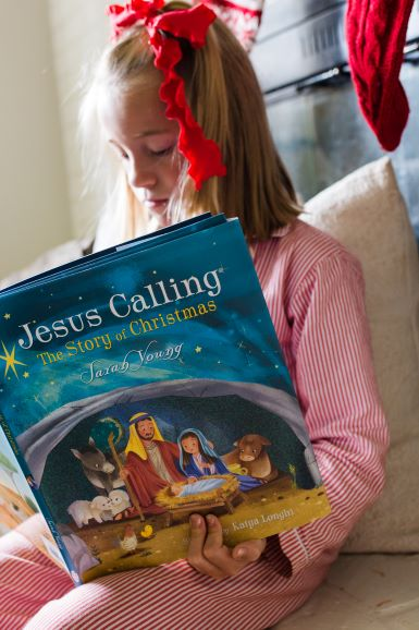 Young girl reading Jesus Calling Story of Christmas