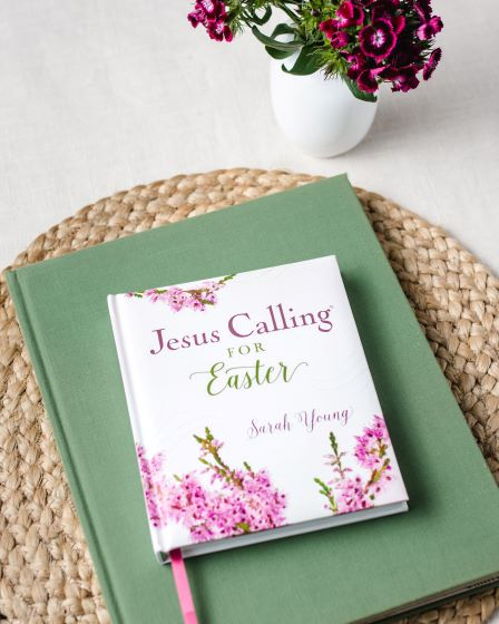 Jesus Calling for Easter on table with flowers