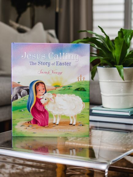 Jesus Calling the Story of Easter Picture Book on a table with a plant